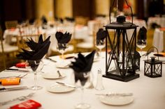 dinner receptions latern centerpiece | Fall Wedding at the Temple for Performing Arts in Iowa : Brides
