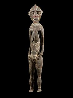 """East Sepik ProvinceYam Figure,   20th century  Wood, pigment  Nogwi was the final part of the ceremonies held during yam harvest observances in which only the most senior and powerful men of the community could participate. Participation in the nogwi ritual was attained through personal achievements, the essential one being homicide the ultimate proof of masculinity. """"Only nogwi members were qualified to plant yams and to know the magic that made them grow."""