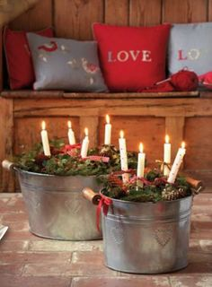Galvanized buckets with pine,  pinecone' s & candles!