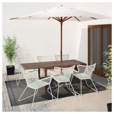 IKEA ÄPPLARÖ/HÖGSTEN Table+6 chairs w armrests, outdoor Brown stained/white The hole in the middle of the table top keeps your parasol in place.
