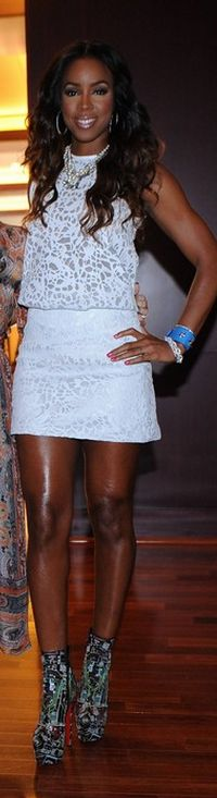 Who made Kelly Rowland's white lace shirt, mini skirt, and print platform boots  that she wore in Los Angeles on July 10, 2013?