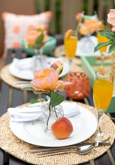 @pizzazzerie creates the perfect spring look for her outdoor spring brunch party with this peachy mint color scheme. Add a pop to your table by mixing in white dinner plates to your set up. Mimosas never looked so good! http://pizzazzerie.com/parties/peach-mint-spring-brunch-party/