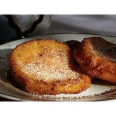 Fried Bread Slices - Rabanadas. It is the equvilant of french toast. It is a sliced loaf bread deep fried in egg batter with cinnamon and sprinkled sugar.