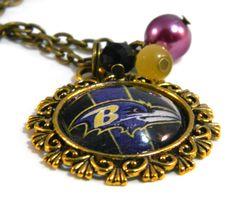 Baltimore Ravens  Beaded Charm Necklace, Purple, Black, Gold. $20.53, via Etsy.