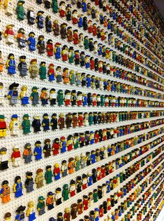 Lego Wall, my son would be in heaven with all his lego men arrange like this in an orderly fashion!