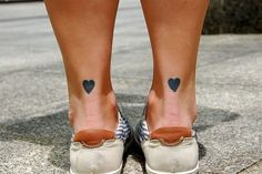 I want 2 tiny tattoos on my ankles one a heart and one a cross symbolizing the two things that keep me going, either in this placement or in my inner heel