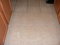 Amazing Grout Cleaner. 7 c water, 1/2 c baking soda, 1/3 c ammonia, 1/4 c vinegar. Spray on, scrub, wipe off.  Will have to try.