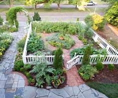 This is what I want for my front yard, but the picket fence would go around the entire front yard.