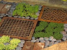 Old heating vent covers as pavers in a garden.