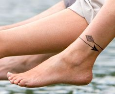 Woman with Arrow Tattoo around the Ankle