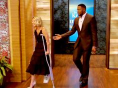Kelly Ripa on crutches and sporting an orthopedic walking boot after breaking her foot in dance class.