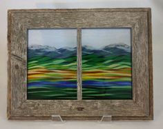 Fused glass tapestry framed in reclaimed barn wood. Landscape inspired by the fields, rivers, lakes, crops, hills and mountains. see more at www.spiritriderstudio.com