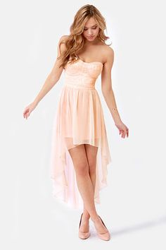 High-Low Profile Strapless Peach Dress! Pinky-peach lace sculpts a stunning bustier bodice with padded cups and a slim banded waistline, while heavenly chiffon falls from where it gathers at the waist into a rippling high-low skirt. Hidden side zipper/hook clasp. Lined to mid-thigh. Model is wearing a size small. Dress measures 22.5