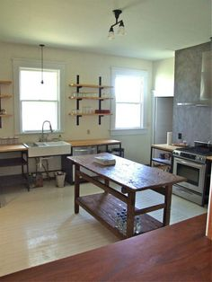 love the old table, and the open wood-top counter elements. and the tile!