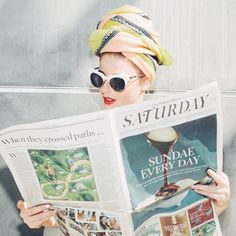 Glamourously reading the newspaper