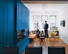 Eric Schneider and Michael Chen take in the space-efficient renovation.  Photo by: Raimund Koch
