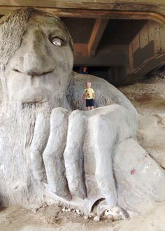 The Quirky Fremont Troll in Seattle Washington. The Fremont Troll is located in the Seattle neighborhood of Fremont. This public art sculpture is located under the north end of the George Washington Memorial Bridge on North Street at Troll Avenue. Seattle Washington, Washington State, George Washington, Oh The Places You'll Go, Places To Travel, Seattle Neighborhoods, Sleepless In Seattle, Graffiti, Beau Site