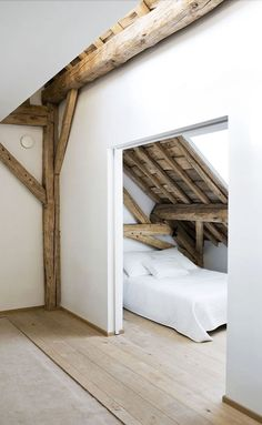 = white and wood loft space