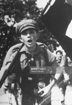 News Photo : Boy in Hitler Youth engaging in various camp...