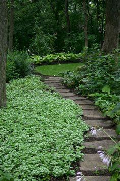 Adorable 63 Affordable and Creative DIY Backyard Garden Path on a Budget https://decorapatio.com/2017/05/31/63-affordable-creative-diy-backyard-garden-path-budget/