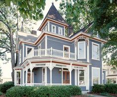 A gray-blue body color, white trim, and rusty red accents on this Queen Anne create a crisp and contemporary three-color scheme that's also rooted in tradition. | Courtesy of: Behr | thisoldhouse.com