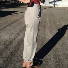 Light-khaki cotton high-waisted trousers -Pleating details -Tag reads 4, would fit up to size 6 -From early 90s