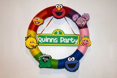 Sesame Street Birthday Wreath 7 Characters by TheSmigShop on Etsy, $35.00  It's spendy, but I love it!