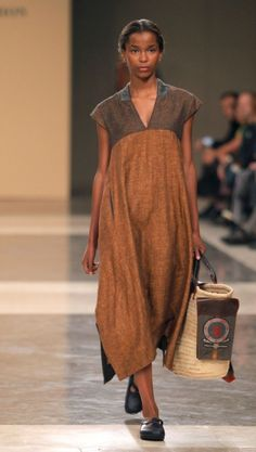 TM COLLECTION. Fall-hued linen. I'd add elbow-length sleeves and copper jewelry--and perhaps a bronze silk headscarf with gold embroidery.