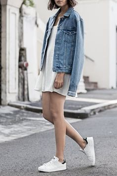 Spring 2016 15 Outfits to Wear with Your New White Sneakers via @PureWow DENIM JACKET AND SILK SLIP DRESS Bonus points for stylish shoulder-draping.