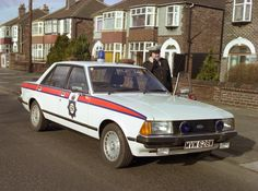 A Greater Manchester Police traffic officer poses with his vehicle in the early… British Police Cars, Old Police Cars, Ford Police, Emergency Vehicles, Police Vehicles, Classic European Cars, Manchester Police, Ford Granada, Classy Cars