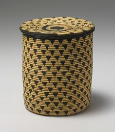 Africa | Lidded basket (Igiseke) from the Tutsi people of Rwanda | 20th century | Dryed grass.  The black dye is derived from boiling banana flowers.