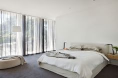 malvern-custom-home canny.com.au. Lots of windows, entrance to robe/ ensuite, curtains