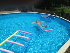 DIY pool float made from noodles and rope.  Use a dowel rod and some duct tape to thread the rope through the noodles.