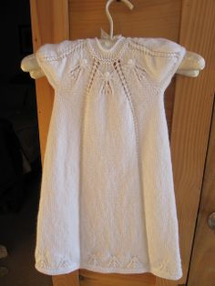 Hand knitted christening dress