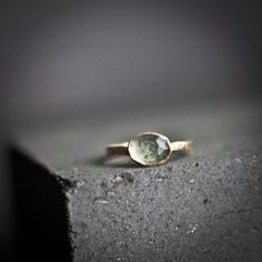 The Amira Ring - Solitaire Rose Cut Pale Green Blue Tourmaline in Rose Gold. $300.00, via Etsy.