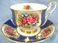 PARAGON COBALT BLUE FANCY GOLD GILT RED ROSES TEA CUP AND SAUCER