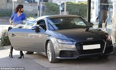 Shifting gear: Lucy is clearly happy to treat herself as the car is worth nearly £30,000...