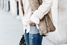 faux fur vest = winter staple... going to get me one of these eventually!
