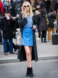 Button front denim skirt worn with a gray trench coat and black ankle boots