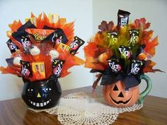 For a playful, kitschy halloween wedding - put a candy arrangement on each table for fun!