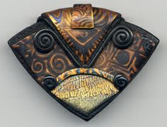 Another fabulous pendant from Polydogz Designs, featured on Polymer Clay Daily