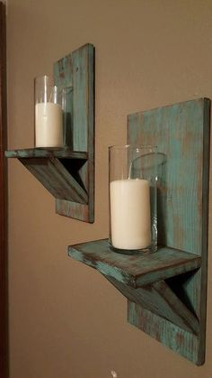 Set of two rustic distressed turquoise candle holders measure 7.5 wide x 18 tall x 6.5 deep. Each candle holder has a sawtooth hanger on the back for easy hanging. A beautiful rustic touch to any room. Glass and candle not included.