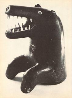bear emerging from the sea, by amidilak, port harrison; from 'eskimo art' by cottie burland (hamlyn, 1973)