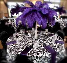 not quite my style but i love the damask table cover and purple feathers. & violet et blanc à voir | Mariage Table decorations and Weddings