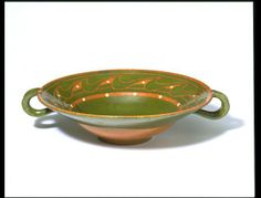 Made in Finland, c1900 and designed by Alfred William Finch, earthenware decorated bowl.