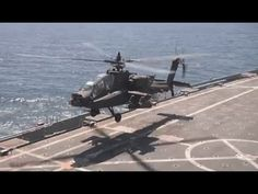 U.S. Army Apache Helicopters Join Up with the U.S. Navy at Sea