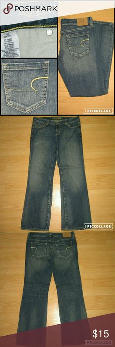 "American Eagle Boyfriend 77 Bootcut Jeans SHORT These jeans are preloved but still in very good condition. They are the Boyfriend 77 which is a relaxed Bootcut jean. I believe these are an earlier version of the Favorite Boyfriend. Made of 99% cotton 1% spandex. Tag size is 10 Short.  Waist across with natural dip is 16.25"" Waist across when aligned is 16.75"" Front Rise is 8"" Inseam is 29.5"" American Eagle Outfitters Jeans Boot Cut"