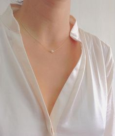 One pearl necklace Simple every day necklace a small swarovski pearl on a simple delicate necklace. The perfect necklace for any woman