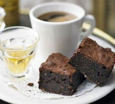 Fudgy Coconut Brownies Recipe, Dense and gooey, these storecupboard treats are made with cocoa rather than bars of chocolate Coconut Brownies, Salted Caramel Brownies, Best Brownies, Fudgy Brownies, Chocolate Brownies, Dark Chocolate Cakes, Salted Chocolate, Chocolate Recipes, Coconut Chocolate