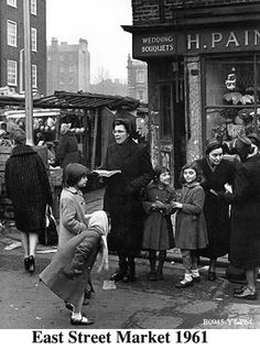 """East Street Market Salvation Army members and children outside a florists. """"East Street is also the birthplace of Charlie Chaplin and features in the title sequence to the television programme Only Fools and Horses. Vintage London, Old London, East End London, South London, Uk History, London History, British History, Old Pictures, Old Photos"""